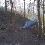 bonfire at missile ridge disc golf course during course design process